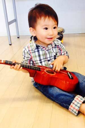 small child with ukelele